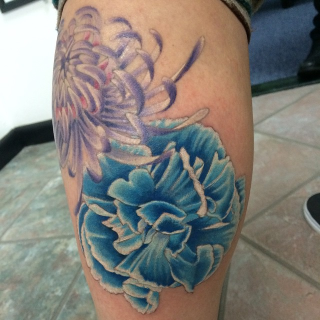 Carnation, fresh. Chrysanthemum, healed. Another flower and background to come. Both by Matt Stankis #northsidetattoosdotcom #northsidetattoos #northsidetattoo #nst #mattstankis #tattoo #carnation #floraltattoo #tattoosforwomen #flowertattoo #colortattoo #delaware